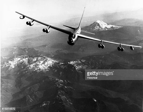 A prototype of the new Boeing B52 Stratofortress bomber takes a test flight over the state of Washington Mount Adams is the peak in the background