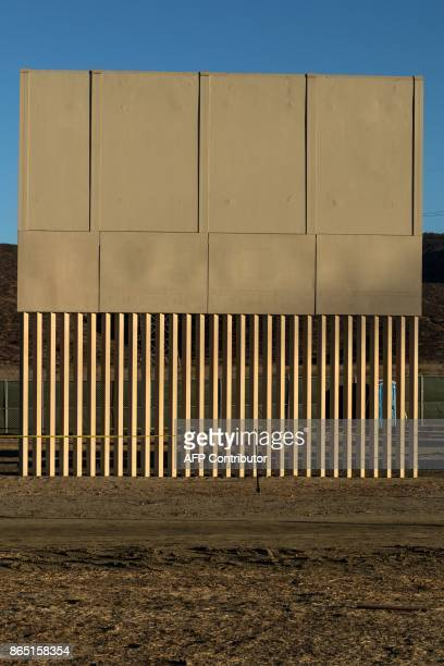 A prototype of US President Donald Trump's USMexico border wall being built near San Diego in the US is seen from across the border from Tijuana...