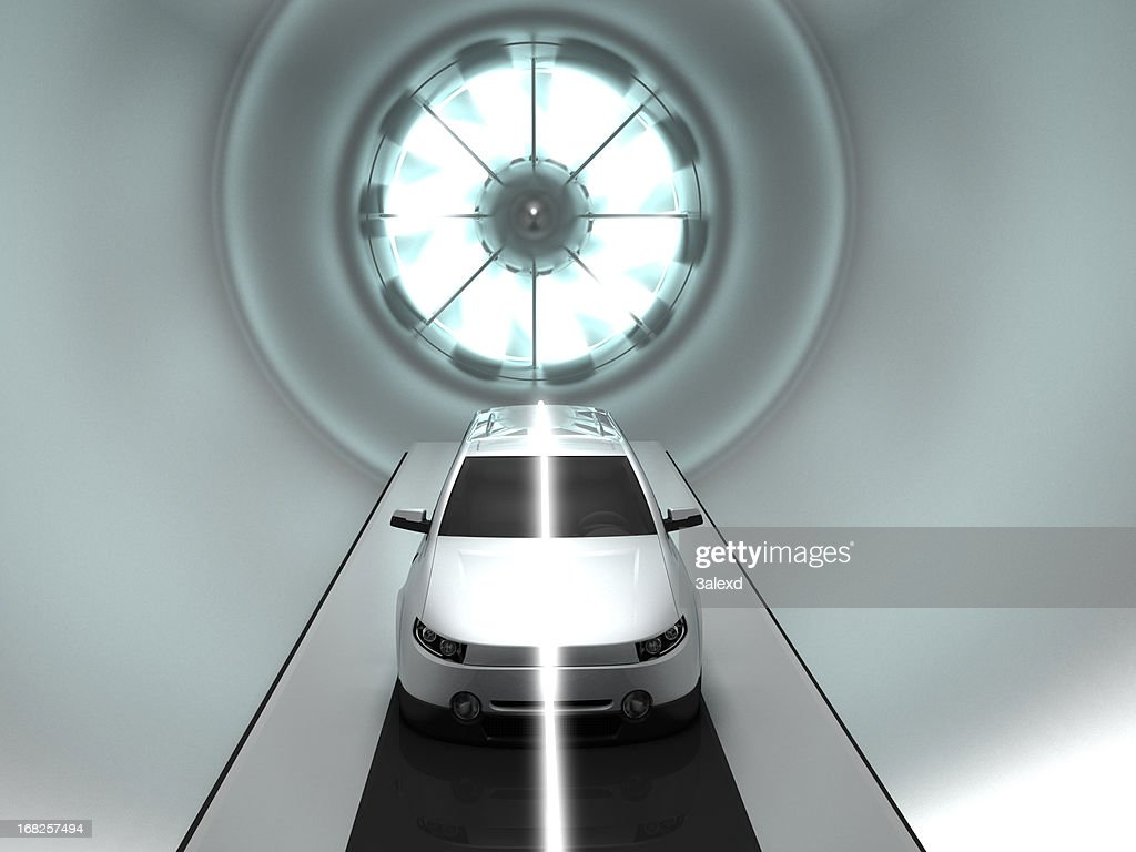 Prototype white vehicle located in a wind tunnel