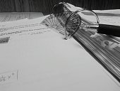 Protractor And Pen On Open Book