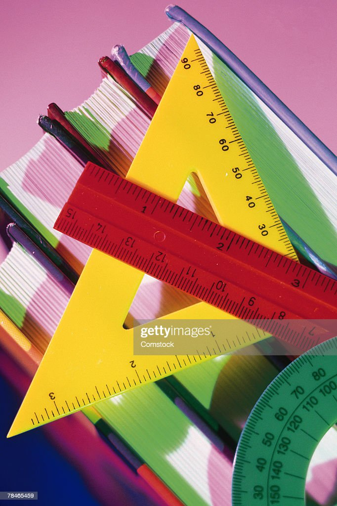 Protractor with ruler and textbooks