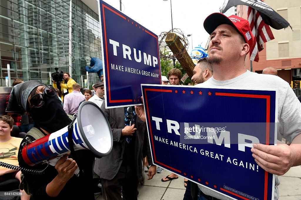Pro-Trump supporter Greg, no last name given, uses a sign to block out a protestors megaphone during an Anti-Trump rally at the corner of 14th and California in Denver, Colorado on June 1, 2016.