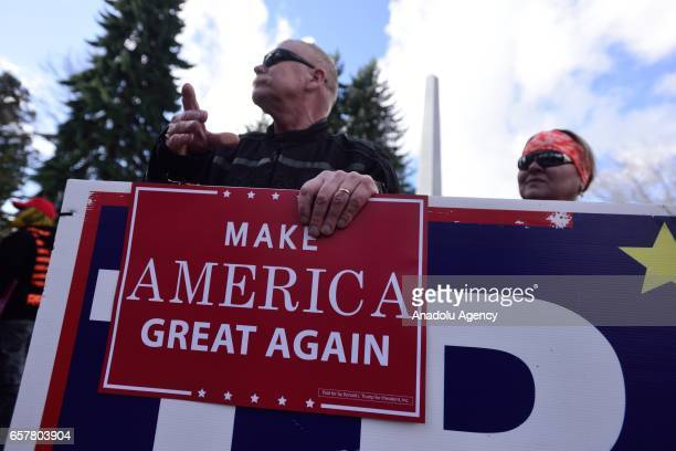 A proTrump supporter holds a sign at a 'Make America Great Again' rally in Salem Oregon United States on March 25 2017
