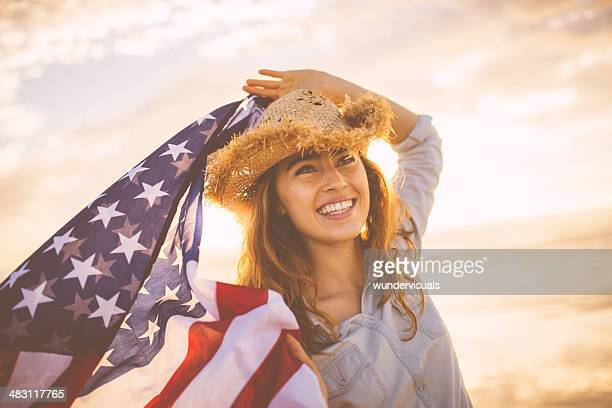 Proud american girl holding stars and stripes