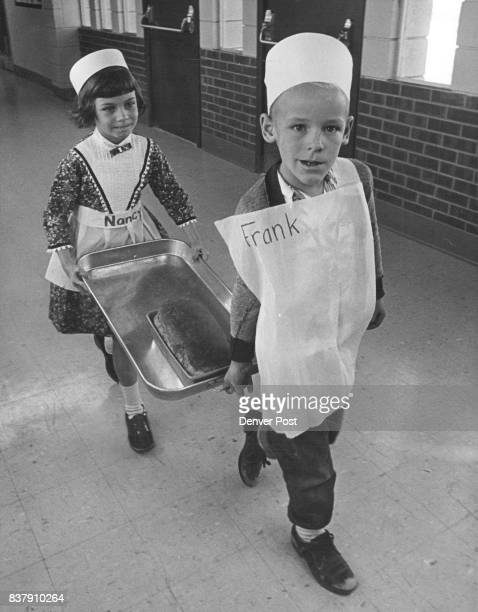 Proud Bearers Carry The Bread To Rest Of Class They are Nancy Curfman 1475 Vancouver Court Frank Rice 13608 W Mississippi Court Both are 6yearolds...