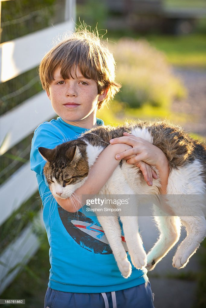 proud boy with large fluffy cat : Stock Photo