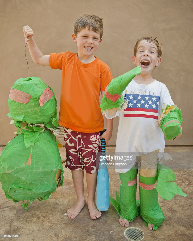 proud boys with a battered pinata : Stock Photo