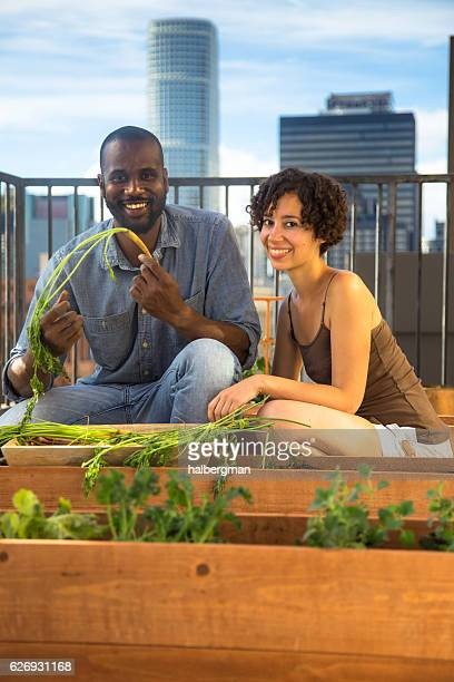 Proud Couple on Rooftop Garden