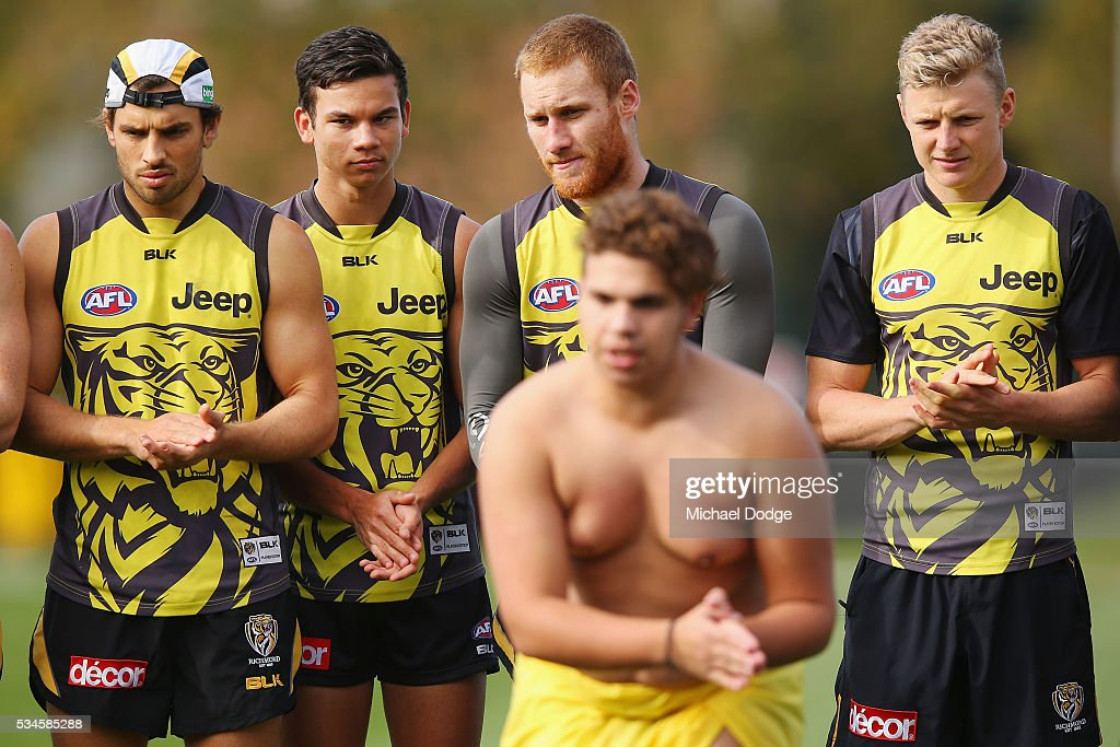 A proud Daniel Rioli (2nd left) watches 16 young Indigenous representatives perform a traditional war cry during a Richmond Tigers AFL training session at ME Bank Centre on May 27, 2016 in Melbourne, Australia. The AFL celebrates Indigenous Round this weekend.