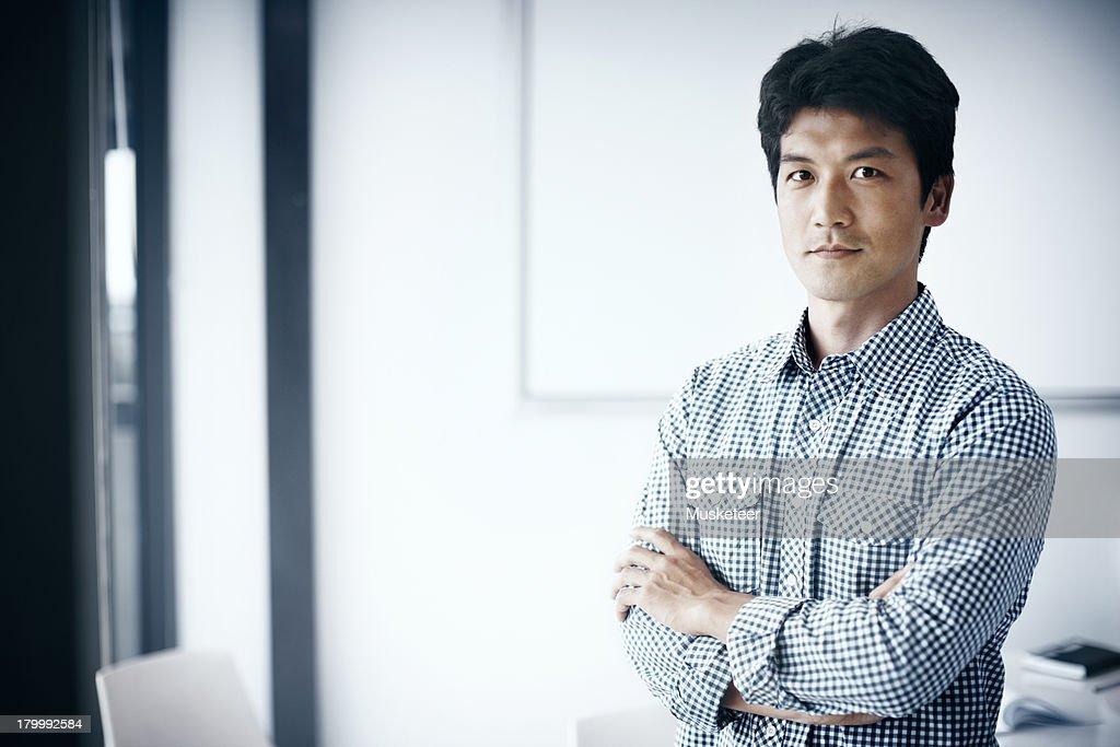 Proud entrepreneur standing in a meeting room