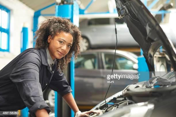 proud female auto mechanic