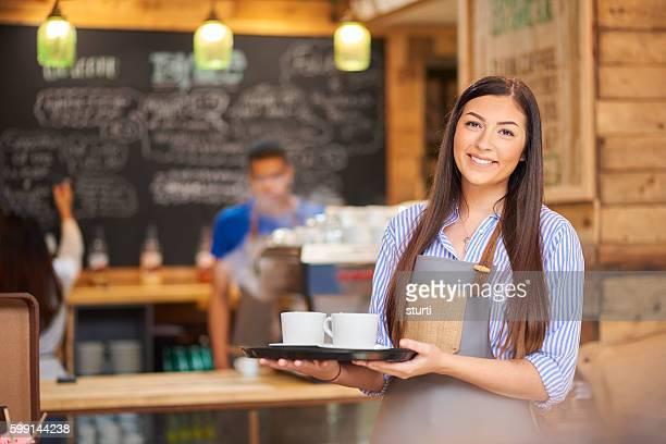 Proud female barista