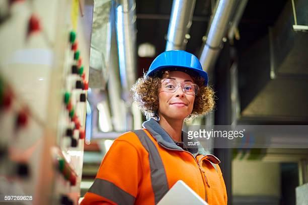 proud female boiler room engineer