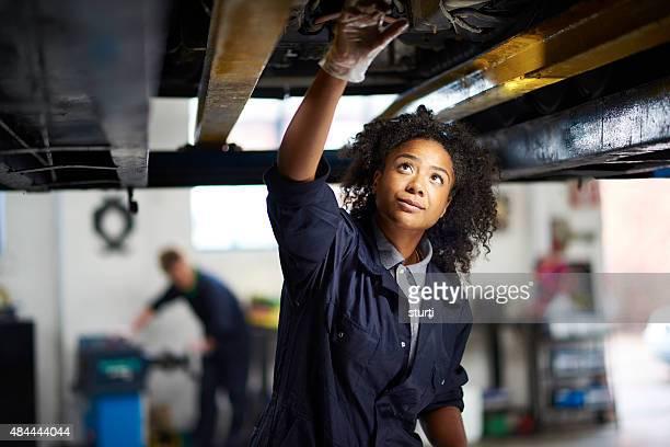 proud female garage mechanic .