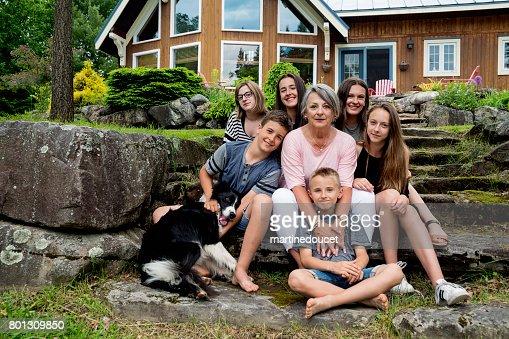 Proud grandmother posing with grandchildren outdoors in summer. : Stock Photo