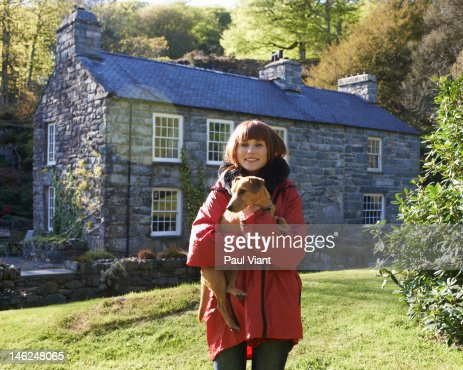 proud home owner with pet dog : Stock Photo