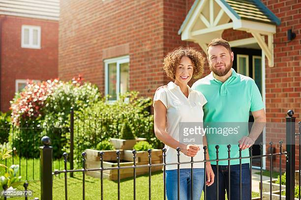proud homeowner couple