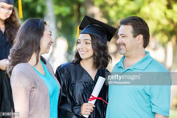 Proud parents congratulate daughter after college graduation