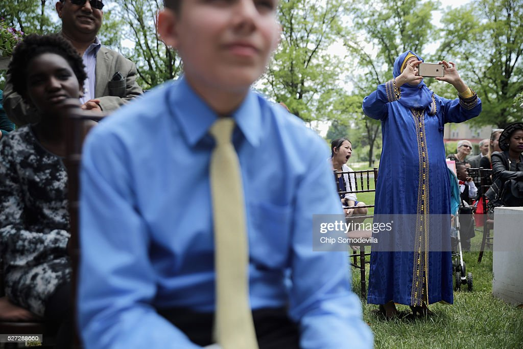Proud parents take photographs during a childrens citizenship ceremony at President Lincoln's Cottage at the Soldiers' Home May 2, 2016 in Washington, DC. Twenty one children from 19 countries, including Syria, South Korea and El Salvador, became new United States citizens during the ceremony sponsored by the U.S. Citizenship and Immigration Services. President Abraham Lincoln and his family resided seasonally on the grounds of the Soldiers' Home to escape the heat and politics of downtown Washington, as did President James Buchanan before him and presidents Rutherford B. Hayes and Chester A. Arthur from 1885 to 1887.