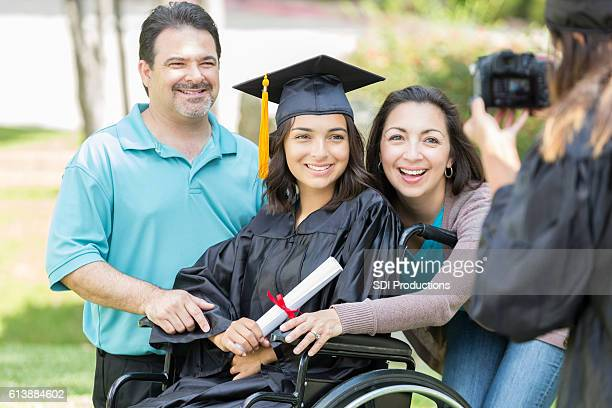 Proud parents with college graduate