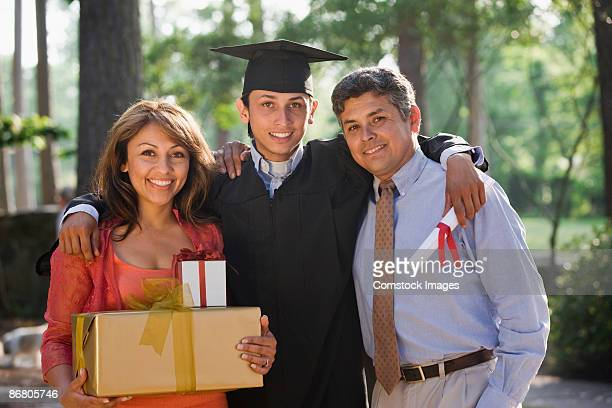Proud parents with smiling graduate
