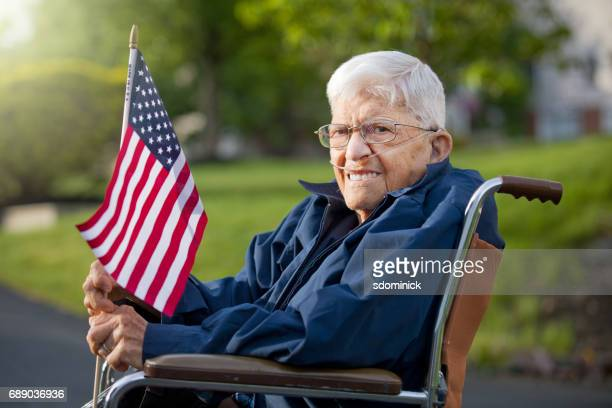Proud Senior Man Veteran Holing US Flag