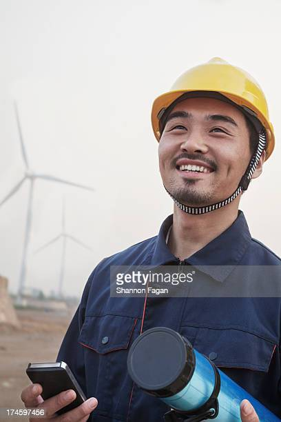 Proud Worker in Front of Windmills
