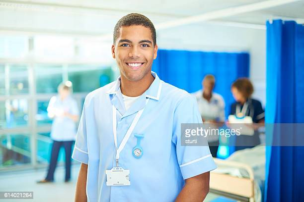 proud young student nurse on the ward