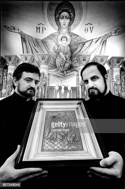 Proudly displaying an Icon of the Anunciation dating from 1448 Fathers Nicholas Papedo left and Christopher Metropulos prepare for a double holliday...
