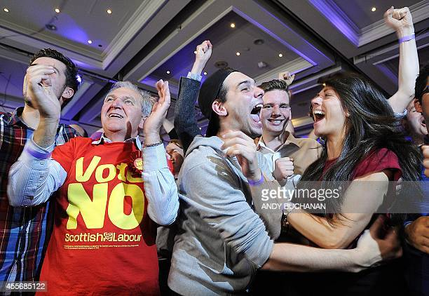 Prounion supporters celebrate as Scottish independence referendum results are announced at a 'Better Together' event in Glasgow Scotland on September...
