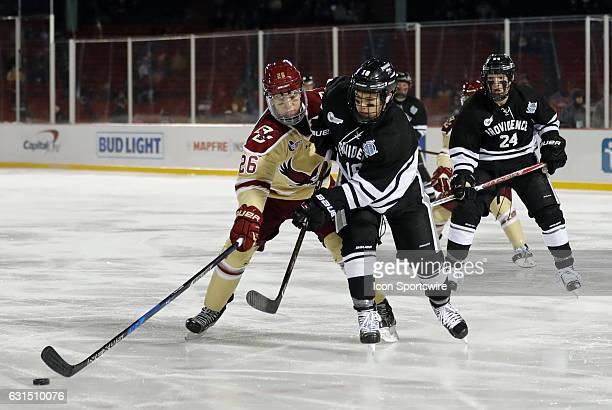 Providence College Friars defenseman Jacob Bryson clears the puck past Boston College Eagles forward Julius Mattila during a Frozen Fenway NCAA Men's...