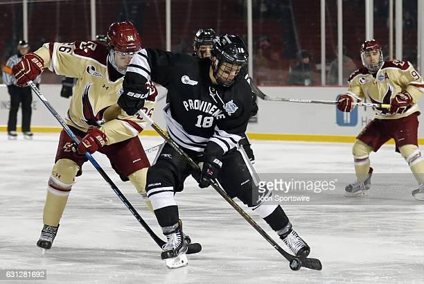 Providence College Friars defenseman Jacob Bryson tries to escape from Boston College Eagles forward Julius Mattila during a Frozen Fenway NCAA Men's...