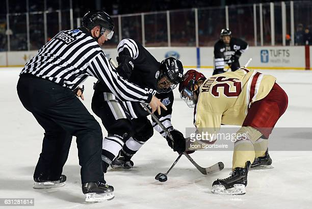 Providence College Friars forward Robbie Hennessey and Boston College Eagles forward Julius Mattila take a face off during a Frozen Fenway NCAA Men's...