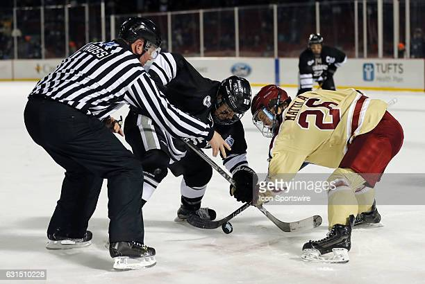 Providence College Friars forward Robbie Hennessey and Boston College Eagles forward Julius Mattila face off during a Frozen Fenway NCAA Men's...