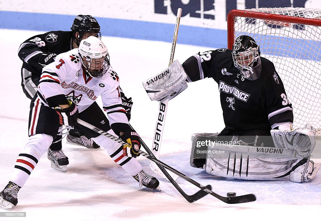 Providence College goalie Jon Gillies, (#32) makes a left toe pad save on a second period shot by Northeastern's Mike McMurtry, (#7) as Northeastern men's ice hockey plats Providence College at Matthews Arena.