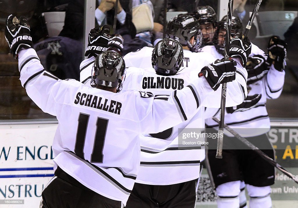 Providence College players celebrate after scoring to tie the game at 3-3 with less than 11 seconds left in the third period. Boston College men's ice hockey. BC plays Providence College at Schneider Arena in Providence, R.I.