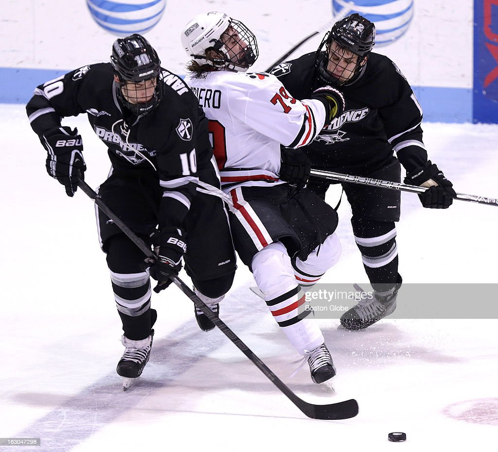 Providence College's Mark Jankowski (#10), and Stefan Demopoulos (#12) put the squeeze on Northeastern University's Cody Ferriero (#79) on this play during the second period as Northeastern men's ice hockey faced Providence College at Matthews Arena.
