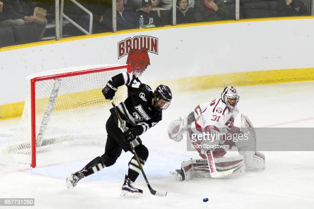 Providence Friars forward Conor MacPhee and Harvard Crimson goalie Merrick Madsen in action during the first period of the NCAA East Regional first...