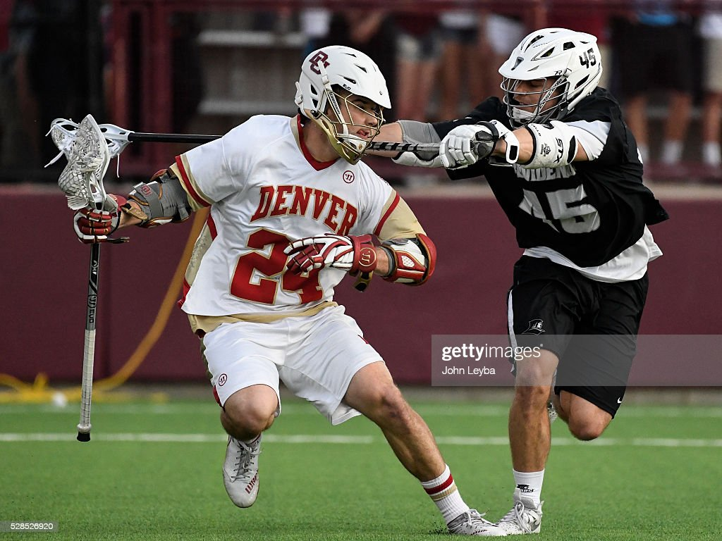 Providence James Barclay (45) checks Denver Connor Donahue (24) with his stick during the first period in a Big East semifinal game May 5, 2016 at Peter Barton Lacrosse Stadium.