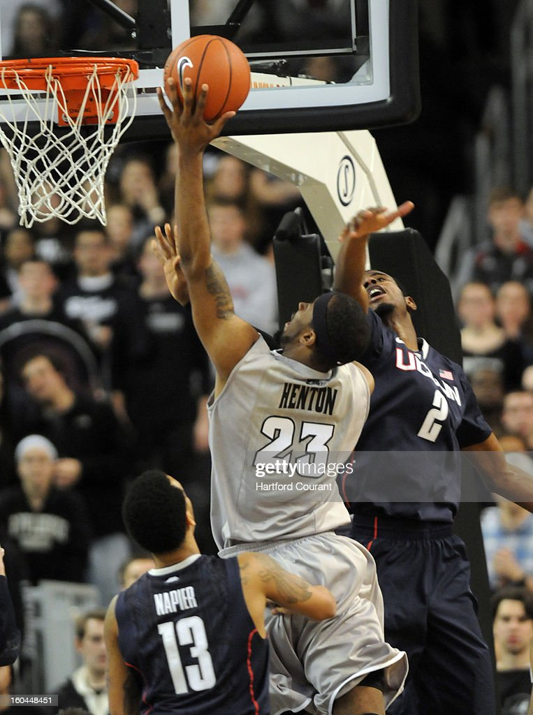 Providence's LaDontae Henton (23) puts up a shot against Connecticut's DeAndre Daniels (2) and Shabazz Napier (13) in the second half at the Dunkin Donuts Center in Providence, Rhode Island, on Thursday, January 31, 2013. UConn won in OT, 82-79.
