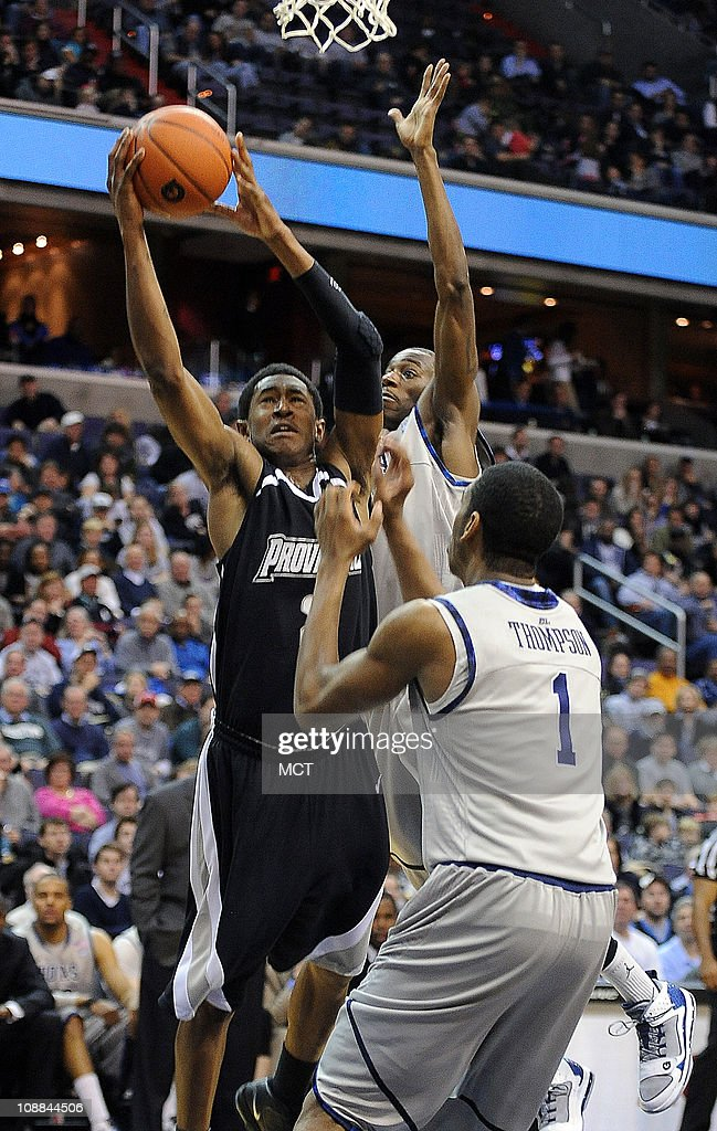 Providence's Marshon Brooks drives to the hoop for a score against Georgetown defenders guard Jason Clark back and forward Hollis Thompson during...