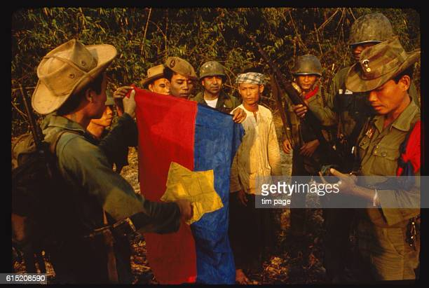 A Province Reconaissance Unit counter insurgency team in the Delta region of Vietnam with a Vietcong flag The Phoenix Programme involved counter...