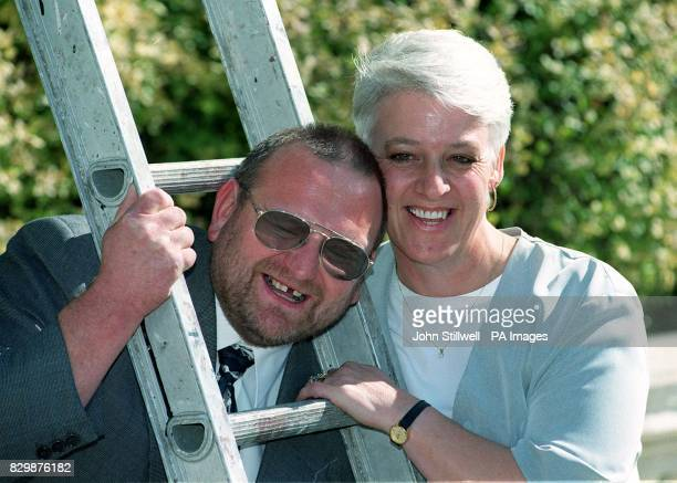 proving that luck can be found under a ladder Bill and Pauline Bunting of King's Lynn Norfolk laugh as they celebrate their National Lottery win of...