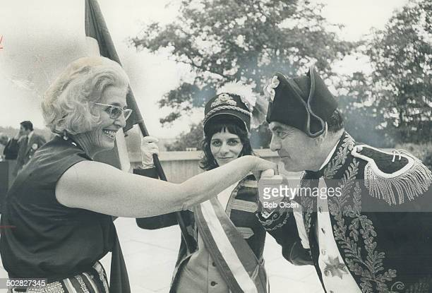 Proving the French are always gallant even during a revolution Napoleon Jerry Palmer Kisses the hand of Marcelle Campana at yesterday's Bastille Day...