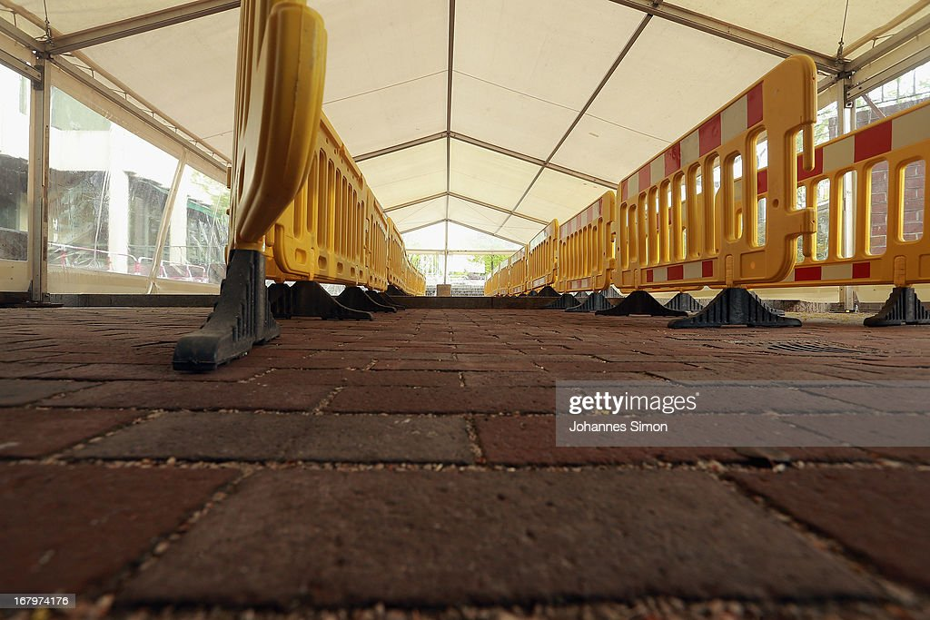 A provisional entrance tent for the press is seen in front of the Oberlandgericht Muenchen, Higher Regional Court Munich, three days before the NSU trial starts on May 3, 2013 in Munich, Germany. Security will be high around the trial, in which Beate Zschaepe, the only surviving member of the NSU neo-Nazi murder trio, and four accused NSU supporters will face charges. The NSU trio murdered at least nine immigrants and one policewoman between 2000 and 2007.