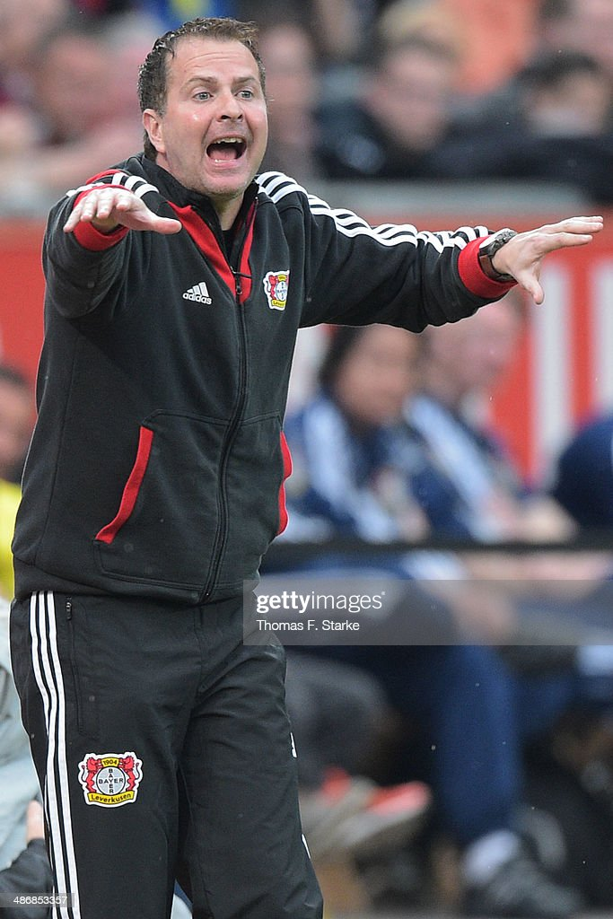 Provisional head coach <a gi-track='captionPersonalityLinkClicked' href=/galleries/search?phrase=Sascha+Lewandowski&family=editorial&specificpeople=5134760 ng-click='$event.stopPropagation()'>Sascha Lewandowski</a> reacts during the Bundesliga match between Bayer Leverkusen and Borussia Dortmund at BayArena on April 26, 2014 in Leverkusen, Germany.