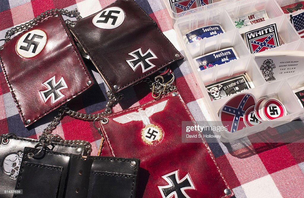 Pro-white merchandise is displayed and sold by vendors at the Aryan Nations sponsored White Heritage Days Festival, which was held on private land September 18, 2004 near Scottsboro, Alabama. Merchandise included everything from T-shirts, stickers, books and bikinis that displayed both southern pride and Nazi memorabilia. The event was originally scheduled as a pro-white family-friendly gathering, yet also served as an East Coast memorial to Pastor Richard G. Butler, the Aryan Nations founder who died about two weeks earlier at his home in Coure D'Alene, Idaho. The family-friendly event was attended by over 100 people, including members of Aryan Nations, White Revolution, the Ku Klux Klan and several independent, but racially conscious people.
