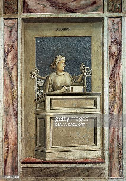 Prudence female figure sitting at a desk looking at the past to learn from experience and reading a book to get teachings for the future by Giotto...