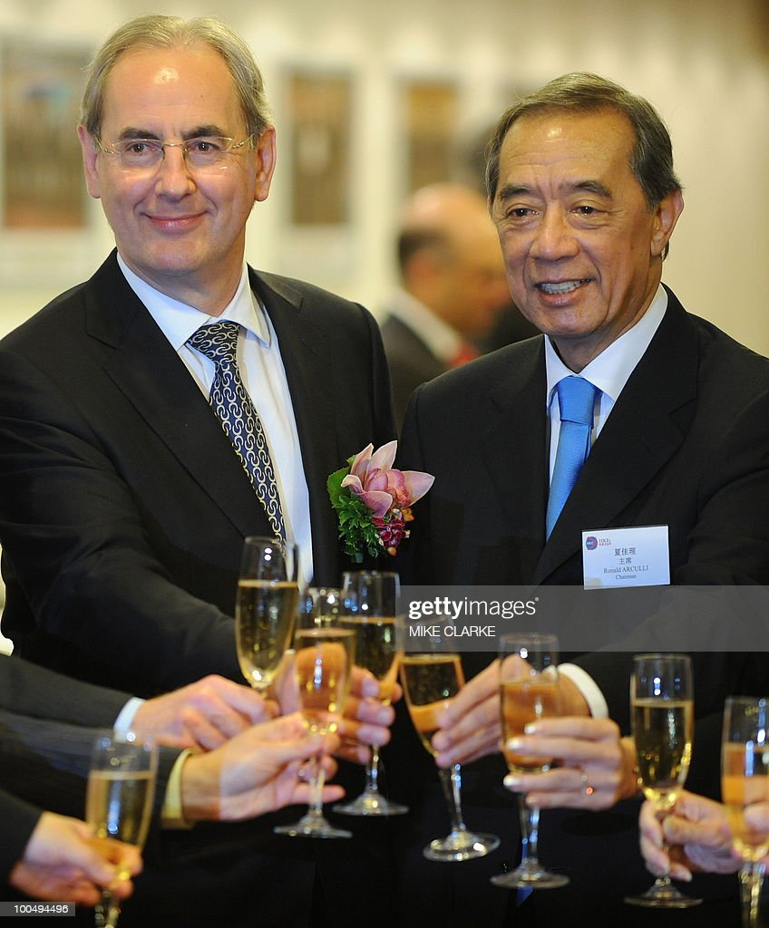 Prudential chairman Harvey McGrath (L) and Ronald Arculli, chairman of ther Hong Kong Exchange (HKEX) toast as they attend Prudential's listing ceremony in Hong Kong on May 25, 2010. McGrath defended a planned takeover of Asian insurer AIA as the British company's shares started trading in Hong Kong and Singapore to help fund the mega-deal. Prudential, which is keeping its primary listing in London, is hoping to woo Asian investors ahead of its planned 21-billion-USD rights issue to buy the Asian arm of troubled US insurer American International Group (AIG).