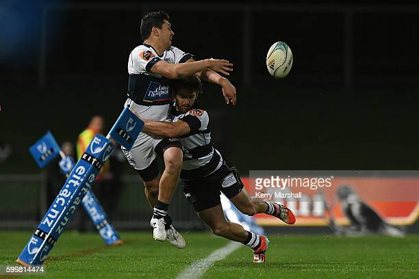 Pryor Collier of Auckland tries to keep the ball in play in the tackle of Mason Emerson of Hawke's Bay during the round four Mitre 10 Cup match...